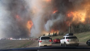 Fort McMurray residents evacuating via Highway 63 as the fire approaches.  Photo RD Darren