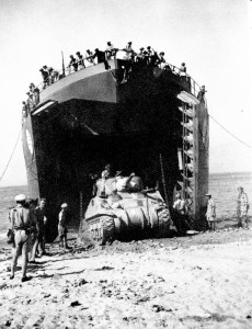 In Army-speak, this is a Landing Ship, Tank (LST) which helped win World War II, disgorging a tank.  This one landed in Sicily in 1943.  Photographer unknown.